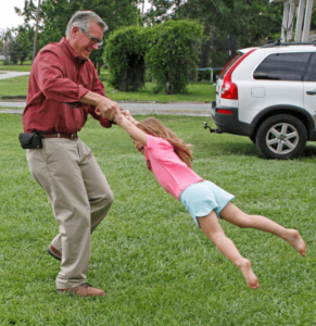 Jim playing with his daughter
